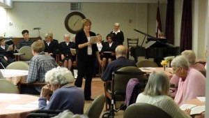 Hymn sing with the group of retirement home residents.