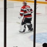 One of the players (#64, the goalie) from the Ottawa 67s hockey team.