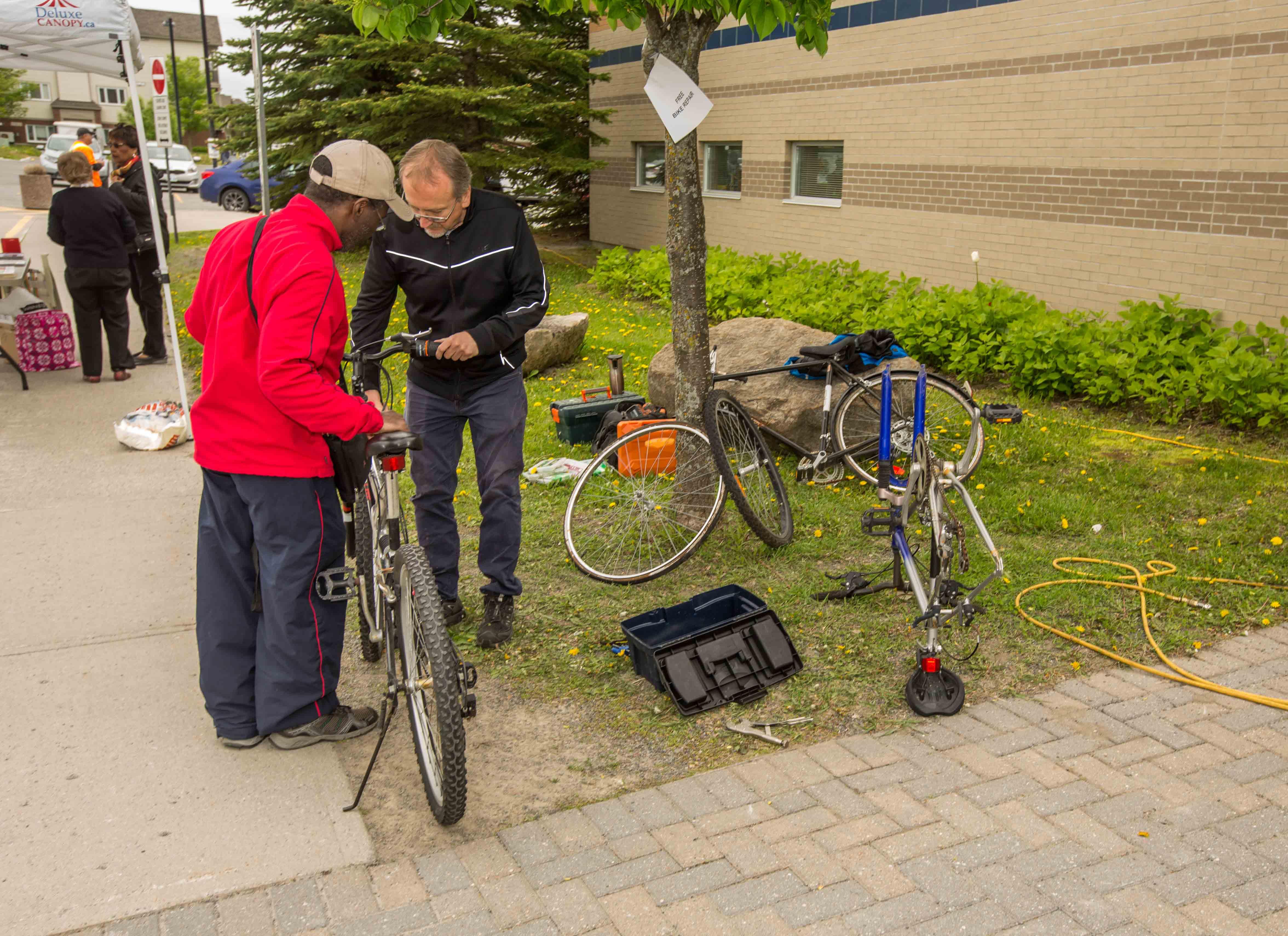 Volunteers offered free bike repair.